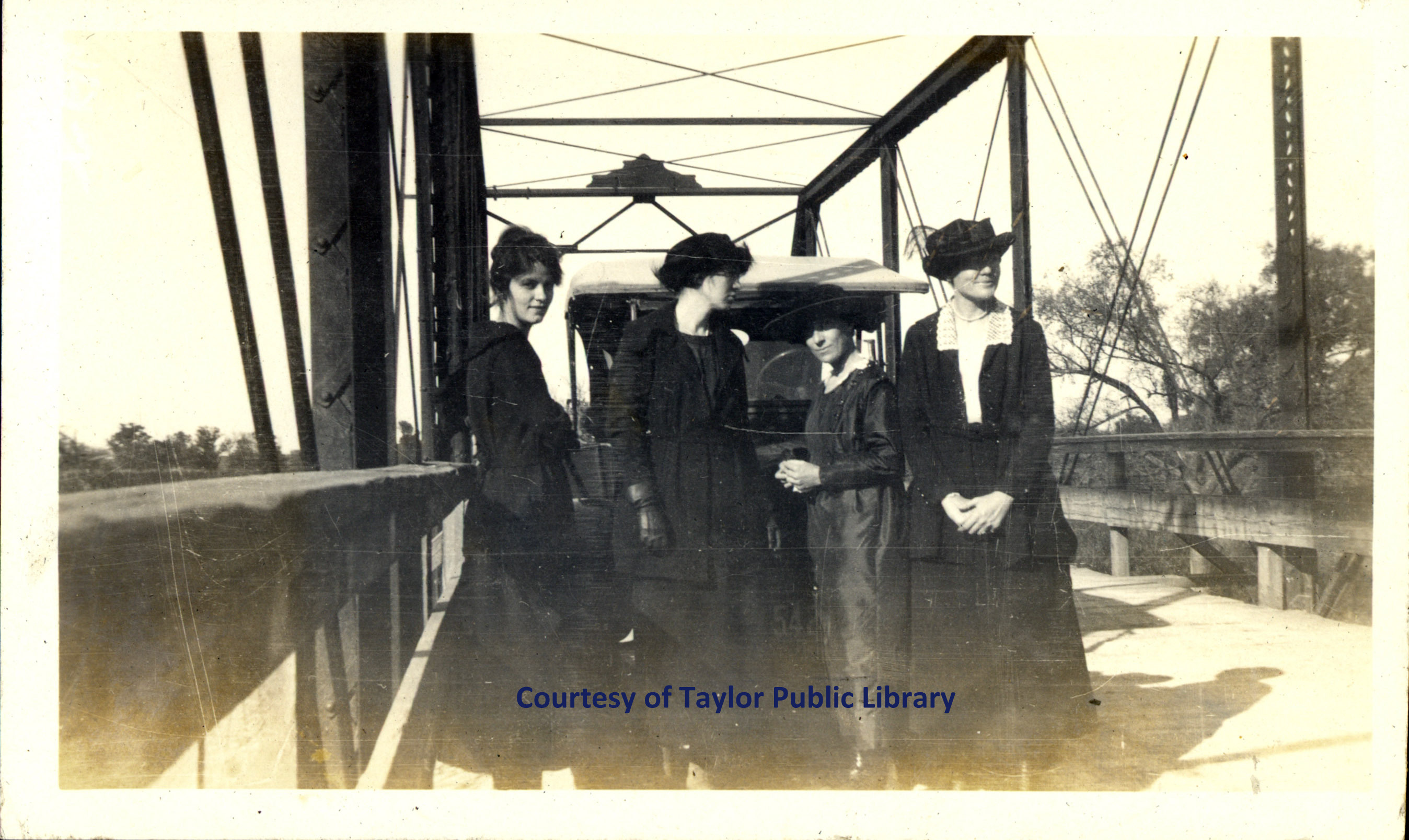 2469 Line of 4 women on bridge0001